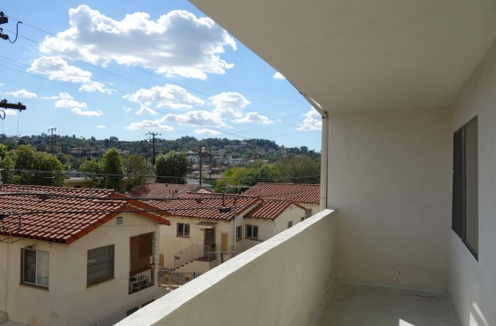 Upstairs Unit with Balcony & $2 Parking Option